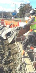 January 2016 - Concrete Finisher Working On Curb at LaGuardia Road
