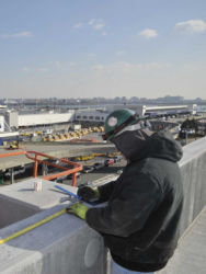 January 2015 - Workers Take Measurement at the Lot P4 Garage Roof Level
