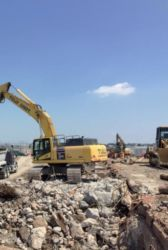 July 2015 - Excavating Debris at the Hangars 2 and 4 Site
